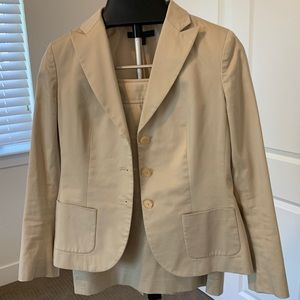Khaki suit jacket with matching pencil skirt.